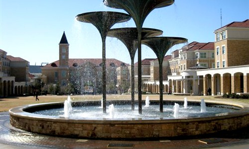 Scharbauer Hall and Residence Halls in Campus Commons with Frog Fountain in foreground at Texas Christian University